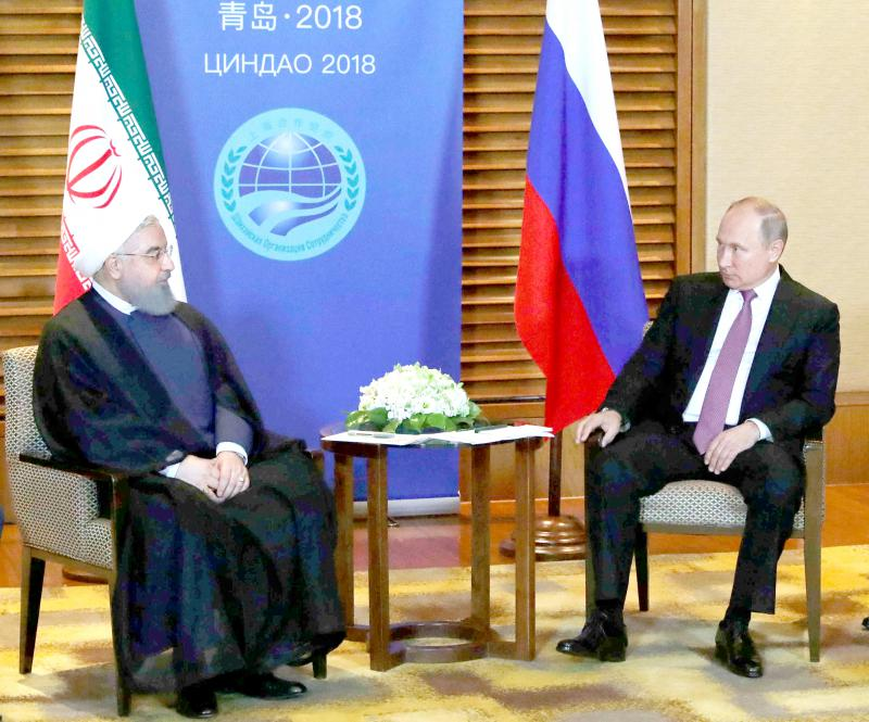Iranian President Hassan Rohani (L) meets with Russian President Vladimir Putin on the sidelines of the Shanghai Cooperation Organisation Summit in China, June 9. (Reuters)