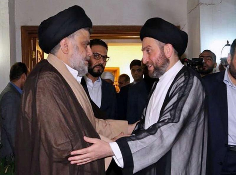 Shia cleric Muqtada al-Sadr (L) greets Shia leader Ammar al-Hakim in Baghdad, on May 22. (Sadr Media Office)