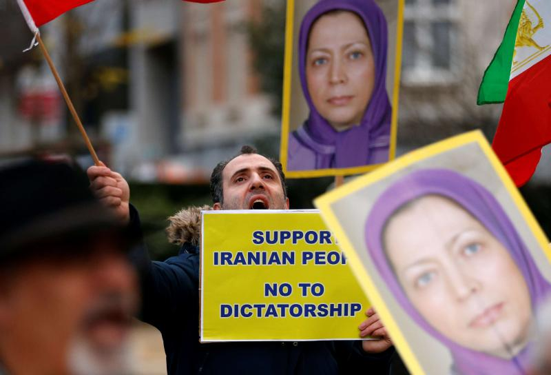 An opponent of Iranian regime chants slogans near placards showing portraits of Maryam Rajavi, the Paris-based head of the MEK's political wing, during a protest in Brussels. (Reuters)