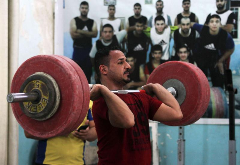 Raad Ameen, a member of the Iraqi national weightlifting team, exercises during a training session at the local weightlifting club in the town of Badra near the Iraq-Iran border, on May 16.