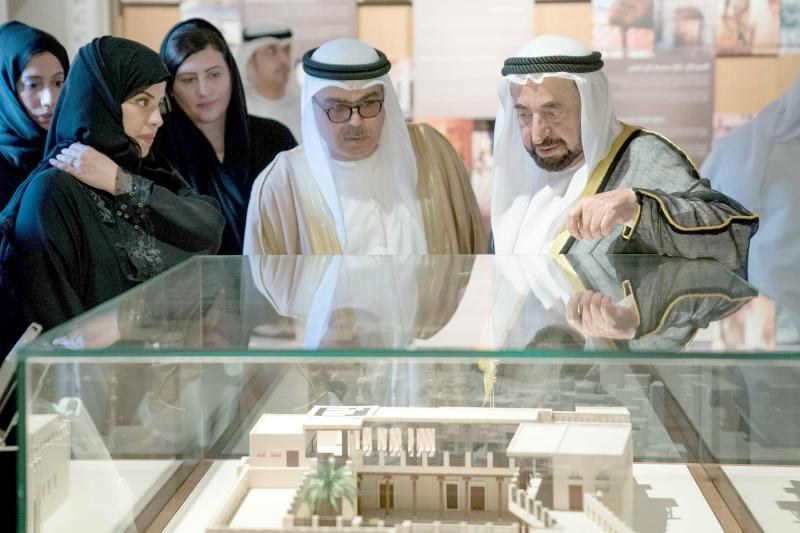 Ruler of Sharjah Sheikh Sultan bin Mohammed al-Qasimi (R) looks at a model of Bait Al Naboodah.(Sharjah Museums Authority)