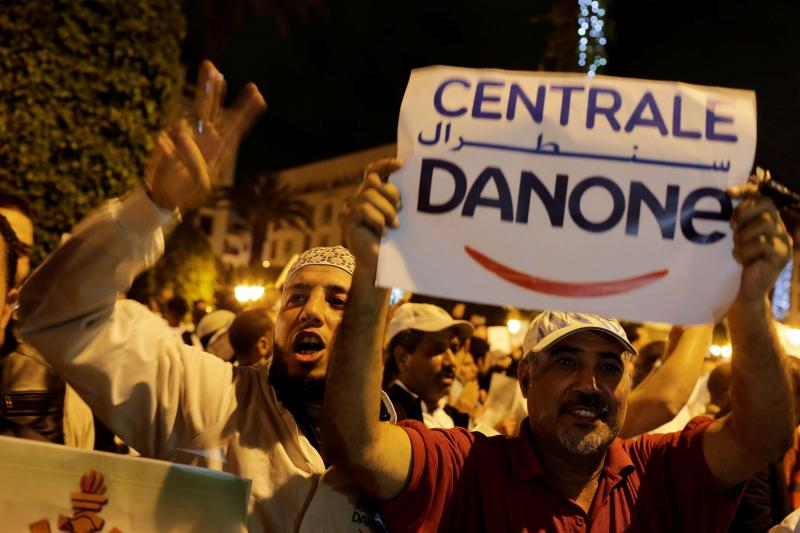 Workers of the Centrale Danone company protest against the boycott of the brand, on June 5. (Reuters)