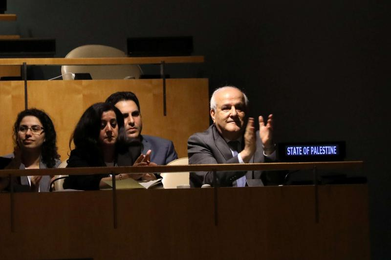 Palestinian Ambassador to the United Nations Riyad Mansour applauds following the adoption of a draft resolution by the UN General Assembly to deplore the use of excessive force by Israeli troops against Palestinian civilians, in New York, on June 13. (Reuters)