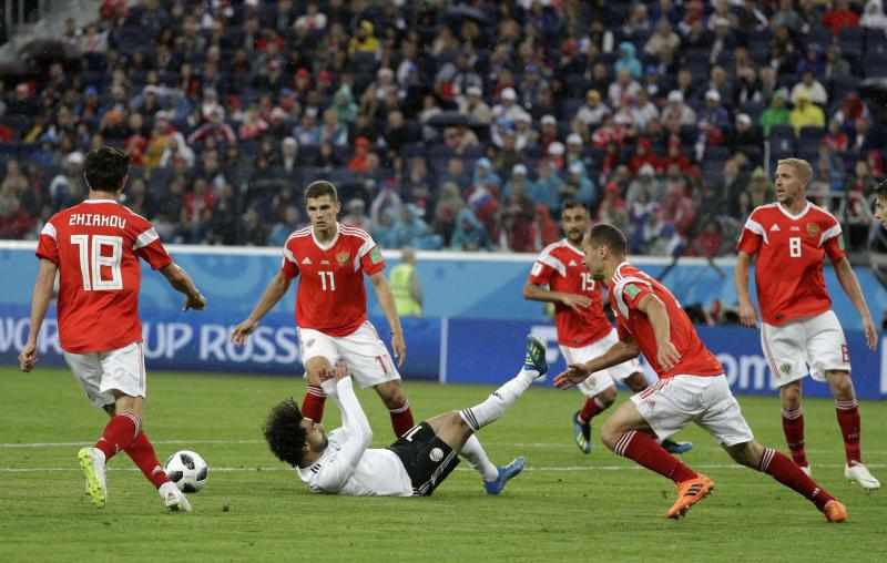 Egypt's Mohamed Salah is fouled in the penalty box during the group A match between Russia and Egypt at the 2018 soccer World Cup in St. Petersburg, Russia, on June 19. (AP)