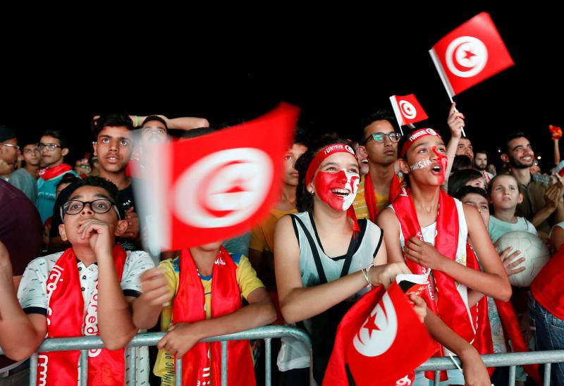 Fans react during the broadcast of the FIFA World Cup Group G soccer match between Tunisia and Panama, in Tunis, Tunisia, June 28. (Reuters)