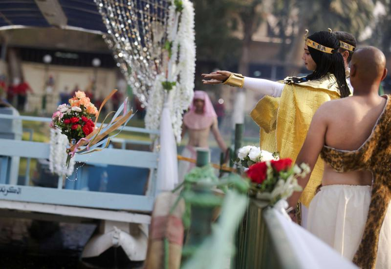 More restrictions. An actress working at the Pharaonic              Village throws flowers into the Nile during the Wafaa El-Nil              Festival in Giza. (AP)