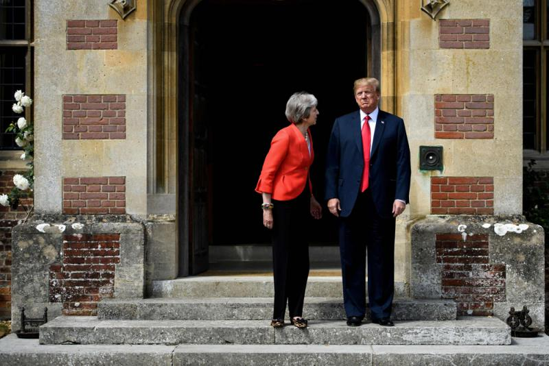 Britain's Prime Minister Theresa May (L) and US President Donald Trump pose on his arrival for a meeting at Chequers, England, on July 13. (AFP)