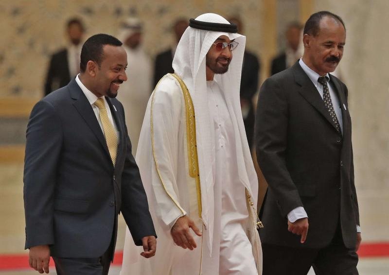 Abu Dhabi Crown Prince Sheikh Mohammed bin Zayed al-Nahyan (C) receives Ethiopian Prime Minister Abiy Ahmed (L) and Eritrean President Isaias Afwerki at the presidential palace in Abu Dhabi, on July 24. (AFP)
