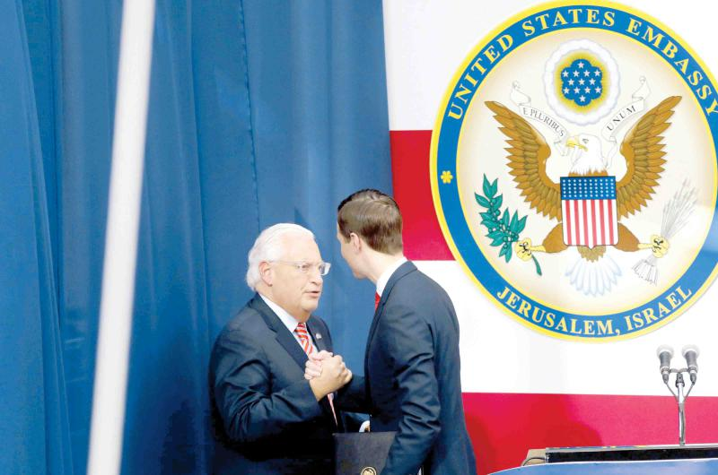 Policy of dictation. US Ambassador to Israel David Friedman (L) and Senior White House Adviser Jared Kushner greet each other on the stage during the opening of the US Embassy in Jerusalem, last May. (AFP)