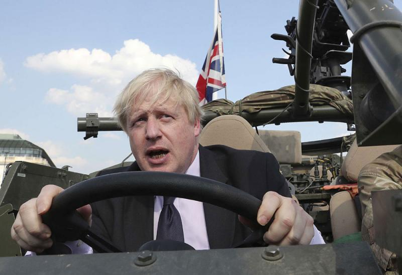 Britain's Foreign Secretary Boris Johnson talks during a ceremony at the Tomb of the Unknown Soldier in Warsaw, Poland, last June. (AP)
