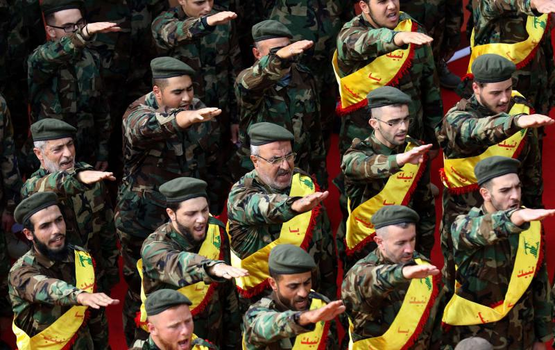 Growing clout. Members of Lebanon's Shia Hezbollah movement salute during a parade in the southern Lebanese city of Nabatieh.  (AFP)