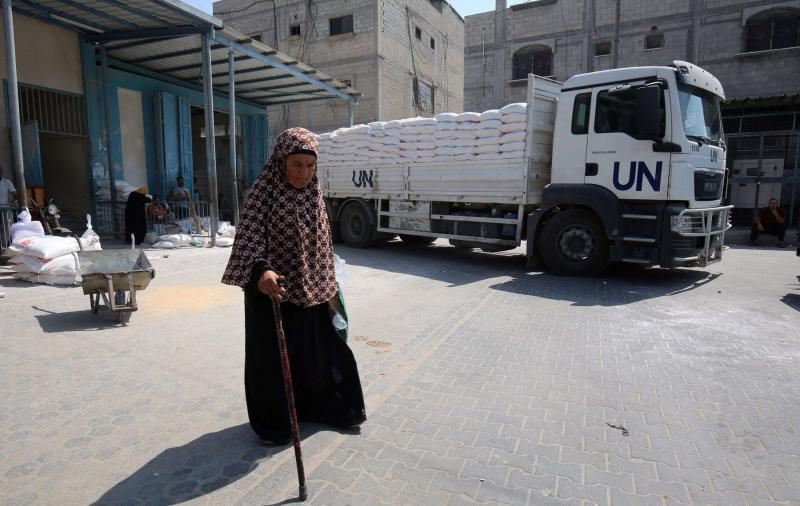 Hard times. A Palestinian woman walks outside an aid distribution centre run by UNRWA in Khan Younis, on September 4. (AFP)