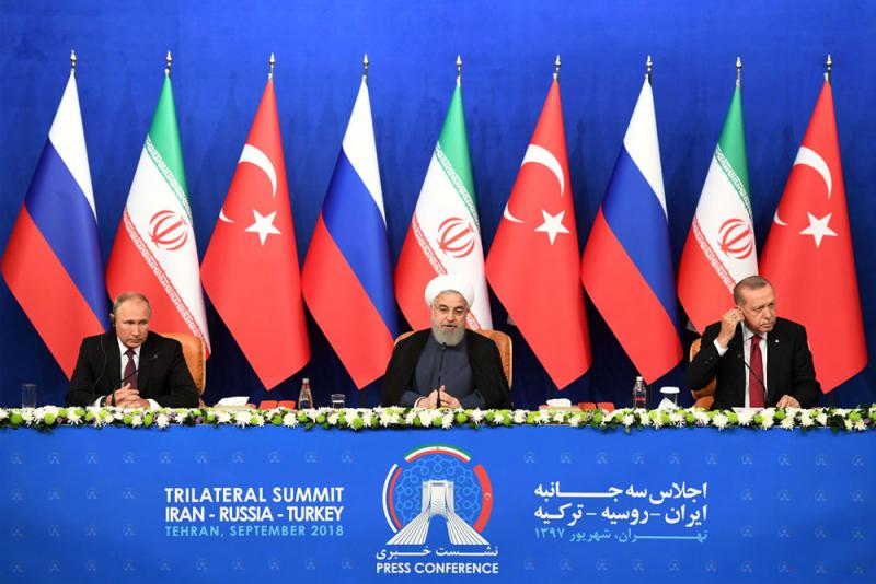 Iranian President Hassan Rouhani (C), Turkish President Recep Tayyip Erdogan (R) and Russian President Vladimir Putin attend a press conference after a trilateral meeting in Tehran on September 7. (AFP)