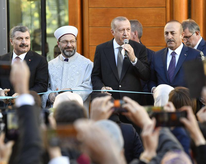 Religious outreach. Turkish President Recep Tayyip Erdogan (2nd-R) cuts the ribbon on the day of the official inauguration of the Cologne Central Mosque in Germany, on September 29. 		     (AP)