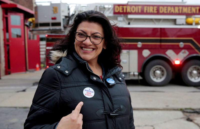 Democratic US congressional candidate Rashida Tlaib points to her 'I voted' sticker after voting during the midterm election in Detroit, Michigan, on November 6. (Reuters)