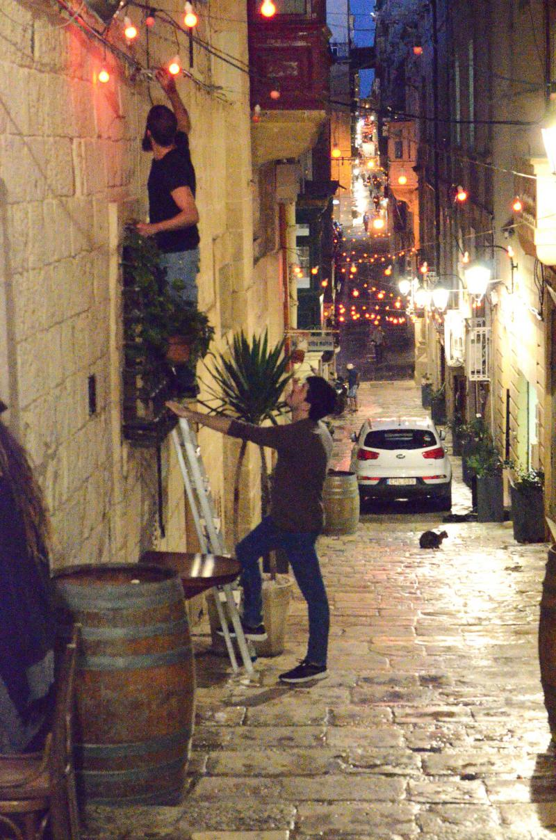 Mixed experience. People prepare for the evening in Valletta.      (Simon Speakman Cordall)