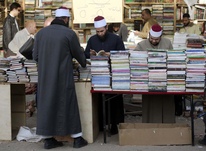 Al-Azhar clerics browse books at Azbakya market in Cairo. (AP)