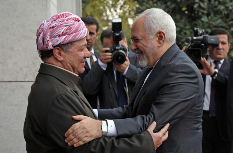 Iranian Foreign Minister Mohammad Javad Zarif (R) is welcomed by the leader of Iraq's Kurdistan Democratic Party, Masoud Barzani, in the Iraqi city of Erbil, on January 15. (AFP)