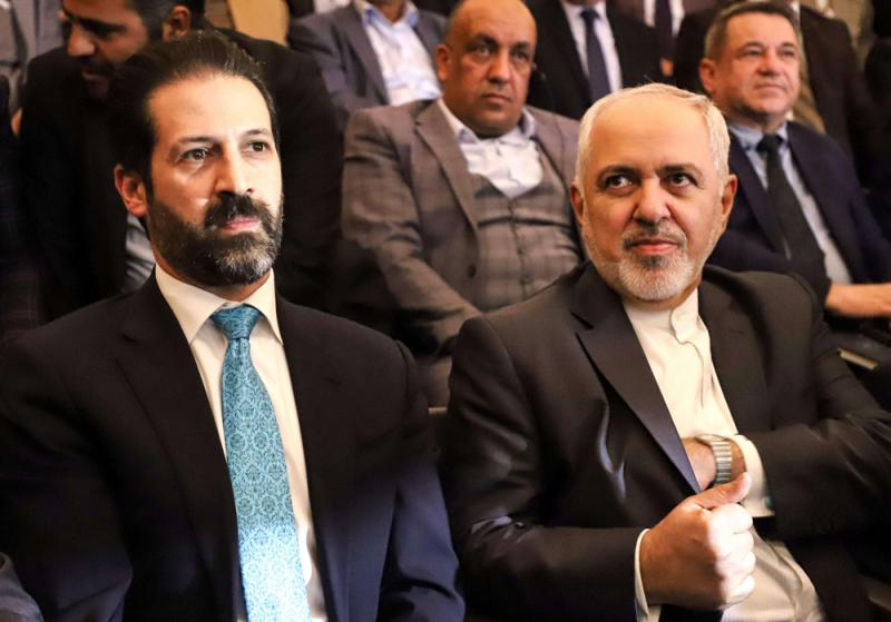 Iranian Foreign Minister Mohammad Javad Zarif (R) sits alongside the Deputy Prime Minister of Iraq's Kurdistan Regional Government, Qubad Talabani, at a joint-trade conference in the Iraqi city of Sulaimaniyah, on January 15. (AFP)