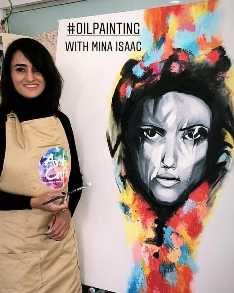 New experience. Arwa Turra stands next to her painting during a workshop with Egyptian artist Mina Isaac at Art Cafe in Maadi. (Art Cafe)
