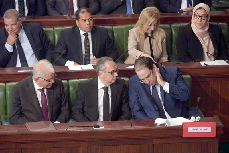 Shifting  balance. Tunisian Prime Minister Youssef  Chahed (R) attends a plenary session at the Tunisian parliament with his government formation. (AFP)