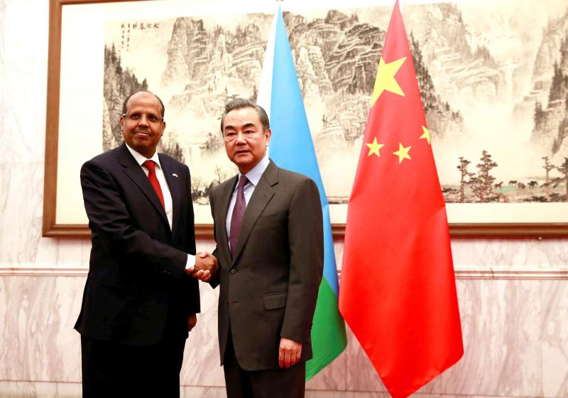 Beyond trade. Djibouti Foreign Minister Mahamoud Ali Youssouf (L) and Chinese Foreign Minister Wang Yi at the Diaoyutai State Guesthouse in Beijing, February 20. (Reuters)