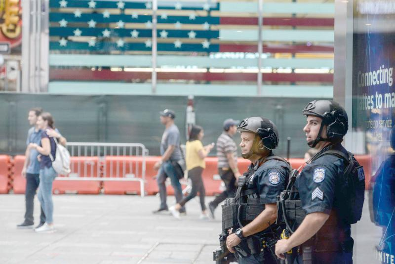 Continued threat. Members of the New York City Police Counterterrorism force stand guard in Times Square in New York City.(AFP)