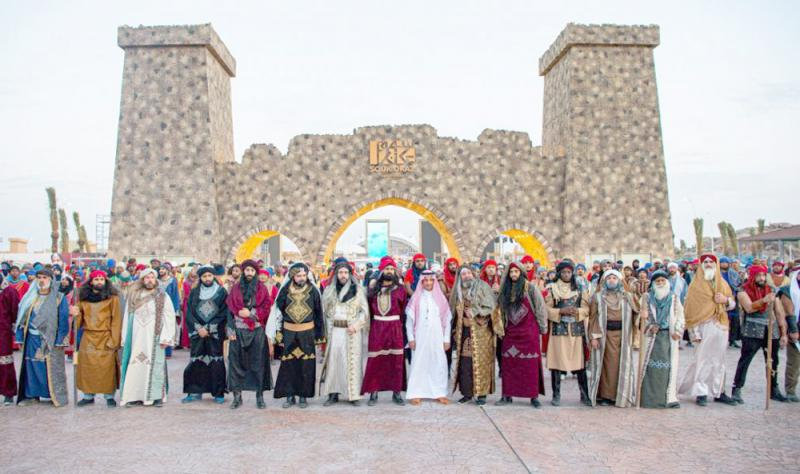 Historical re-enactors pose at the entrance of the Souk Okaz Festival in Taif.(AFP)