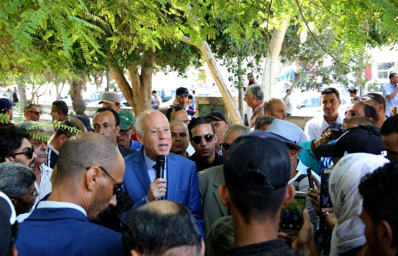 Tunisian presidential candidate Kais Saied speaks to a crowd in the central Tunisian city of Gafsa on September 7. (AFP)