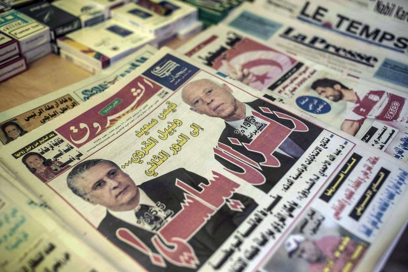 A newspaper stand shows Kais Saied, right, and Nabil Karoui on the front page of Al-Shorouk daily,newspaper a day after the first round of presidential elections in Tunis, September 16. (AP)