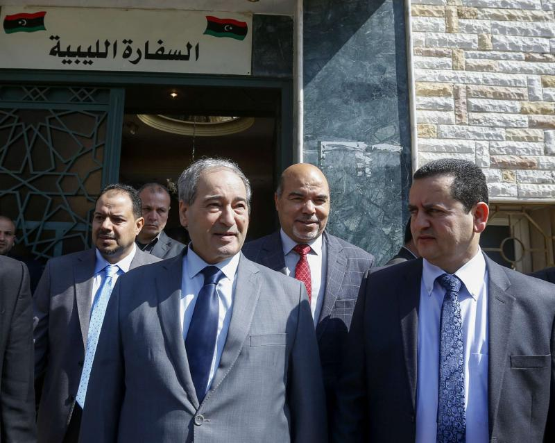 Syrian Deputy Foreign Minister Faisal Miqdad (front L) and Libya's eastern government foreign minister Abdulhadi Lahweej (front R) and deputy Prime Minister Abdul Rahman Al-Ahiresh (back R), leave the Libyan Embassy in Damascus. (AFP)