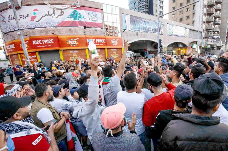 Several hundred Lebanese protest in the northern city of Tripoli despite the country's coronavirus lockdown, April 17. (AFP)