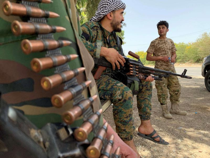 Militants loyal to Libya's Turkish-backed government in Tripoli. (REUTERS)