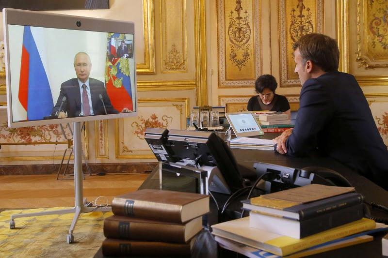 French President Emmanuel Macron talks to Russian President Vladimir Putin during a video conference Friday, June 26, at the Elysee Palace in Paris. (AP)