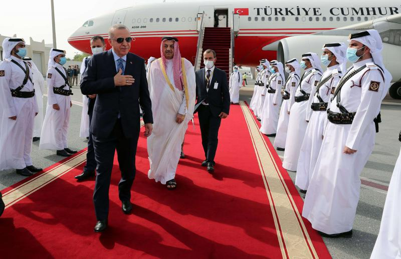 Qatari Deputy Prime Minister and Minister of State for Defense Affairs Khalid bin Mohammad al-Attiyah (C) welcomes Turkish President Recep Tayyip Erdogan (L) upon his arrival in Doha, July 2. (AFP)