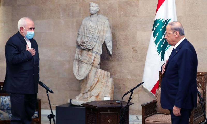 Lebanon's President Michel Aoun (R) receives Iranian foreign Minister Javad Zarifat at the presidential palace in Baabda, in Beirut, August 14. (AFP)