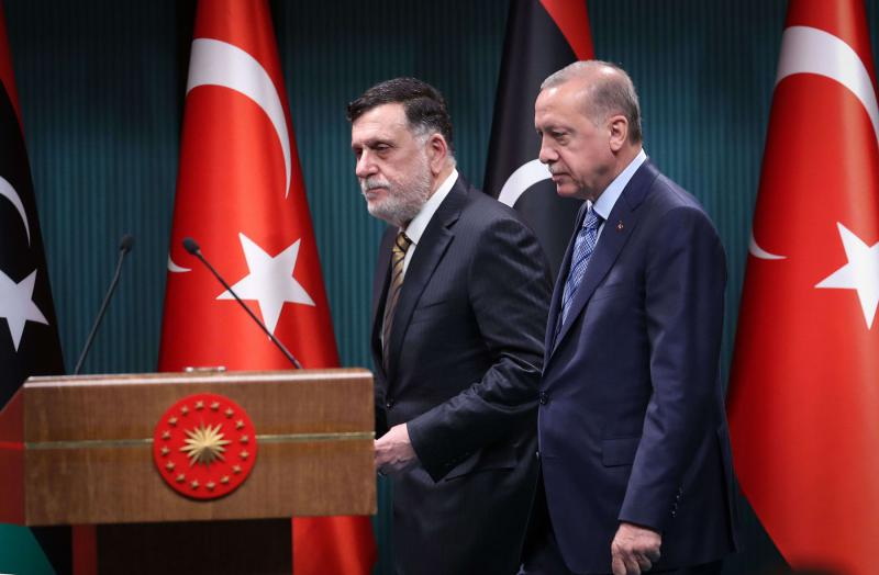 Turkish President Recep Tayyip Erdogan (R) and Libyan Prime Minister Fayez al-Sarraj (L) arrive for a joint press conference in Ankara on June 4, 2020. (AFP)
