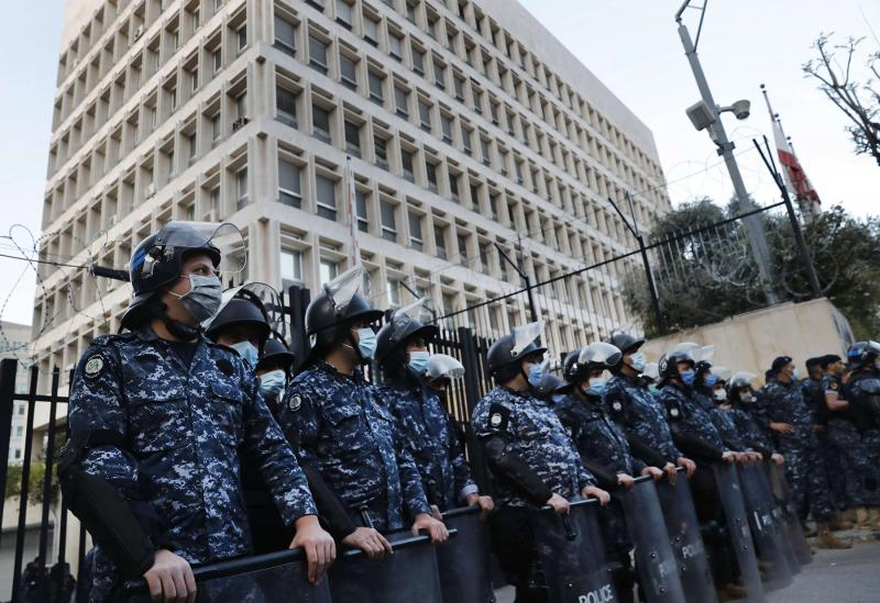 A file photo shows Lebanese riot police standing guard in front of the Central Bank building, in Beirut, Lebanon. (AP)