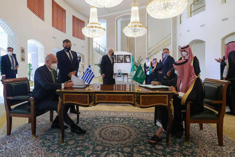 Saudi Arabia's Foreign Minister Prince Faisal bin Farhan Al Saud and Greek Foreign Minister Nikos Dendias, sign agreements in Riyadh, Saudi Arabia April 20, 2021. (REUTERS)