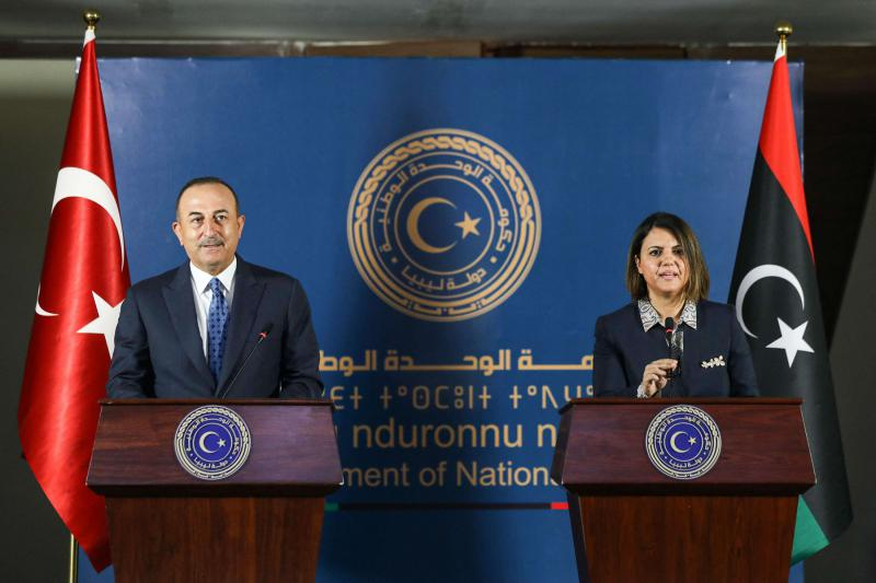 Libya's Foreign Minister Najla al-Mangoush and Turkish counterpart Mevlut Cavusoglu give a joint press conference in the capital Tripoli on May 3, 2021. (AFP)