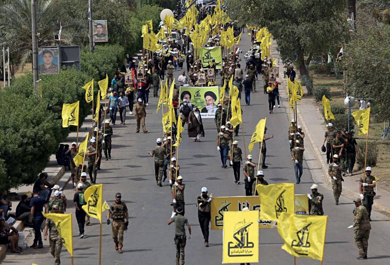 A file photo shows Iraqi Popular Mobilisation Forces marching in Baghdad. (AFP)
