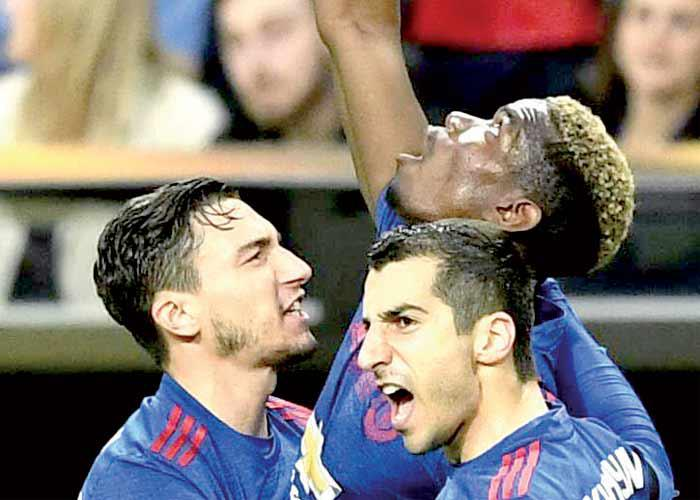 555d7e809ea7 Manchester United s French midfielder Paul Pogba (C) celebrates with  teammates after scoring during the 2017 UEFA Europa League Final