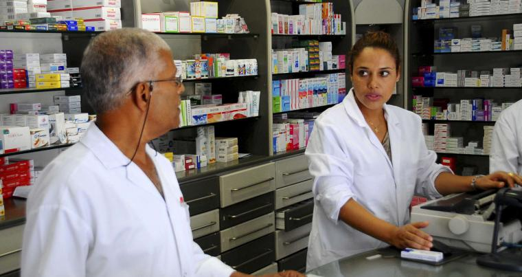 Vital role. A Tunisian woman pharmacist (R) works at a drugstore in Tunis.  (AP)
