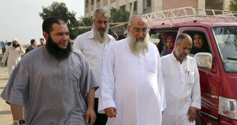 Problematic support. A file picture shows Salafist leader Yasser al-Borhamy (C) walking with his supporters in Alexandria. (Reuters)