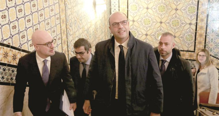 Italian Foreign Minister Angelino Alfano (C) arrives at the government headquarters in Tunis, on January 16.  (AP)