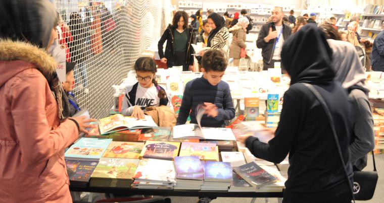 Visitors browse books at the 24th Casablanca International Book Fair.    (Saad Guerraoui)