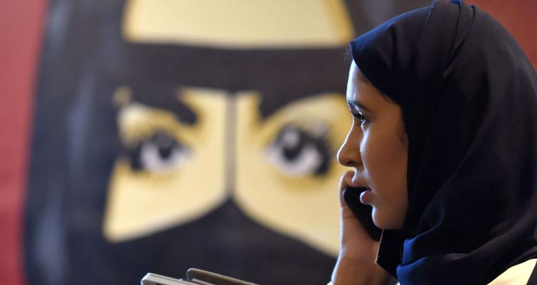 "Saudi woman talks on her phone during the ""MiSK Global Forum"" held under the slogan ""Meeting the Challenge of Change"" in Riyadh, last November. (AFP)"
