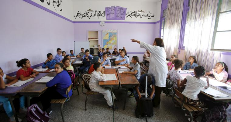 Schoolchildren listen to their teacher at the Oudaya primary school in Rabat.   (Reuters)
