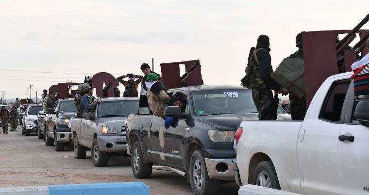 A convoy of pro-Syrian government fighters arriving in Syria's northern region of Afrin on February 20. (AFP)