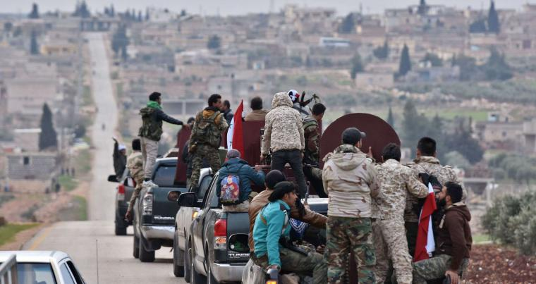 A convoy of pro-Syrian government fighters arrive in Syria's northern region of Afrin, on February 20.(AFP)
